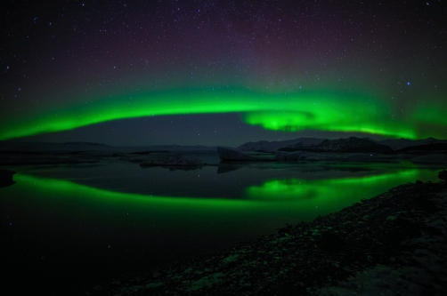aurora borealis is dancing over the...